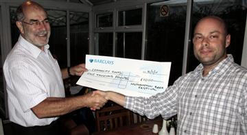 Duncan Reade from Community Roots receives a cheque from donations at Southampton Beer Festival